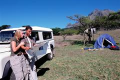 Stock Photo of Couple on a safari looking at a map