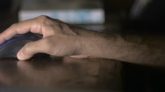 A man's hand operating a wireless computer mouse close up dolly Stock Footage