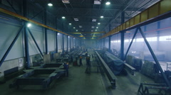 Timelapse footage of a heavy industry factory with workers and flying sparks Stock Footage