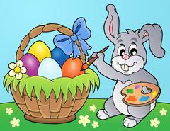 Bunny painting eggs in basket - eps10 vector illustration. Stock Illustration