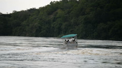 Tourists on the boat at Murchison Falls National Park, Uganda, Africa Stock Footage