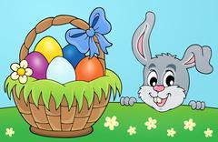 Decorative egg basket and lurking bunny - eps10 vector illustration. Stock Illustration