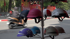 Safety helmets for motorbikes for sale, local shop in Hanoi, Vietnam, Asia Stock Footage
