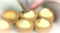 Confectioner prepares tartlets Stock Footage