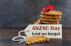 Australian Anzac biscuits with Anzac DAy, Lest We Forget message on dark wood Stock Photos
