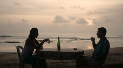 Couple enjoying wine at beach together Stock Footage