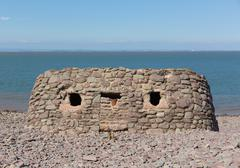 Stone structure built on Porlock Weir beach Somerset uk - stock photo