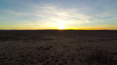 Mojave barren landscape desert with sunset on the horizon 4k aerial stabilized Stock Footage