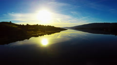 Pristine Calm lake glass reflections of blue sky sunset mountains 4k Aerial Stock Footage