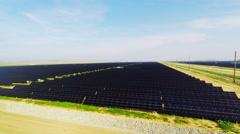 Solar Farm Overhead 4k aerial alternative energy sun power farm in California Stock Footage