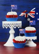 Stock Photo of Happy Australia Day January 26 party food with red velvet cupcakes with kanga