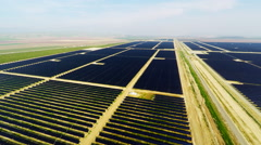 Solar Panel Farm alternative renewable energy Aerial 4k in California Valley Stock Footage