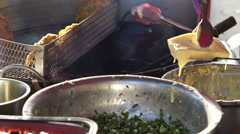 Street food stall chef cooking deep fried taiwanese bun stuffed with meat inside Stock Footage