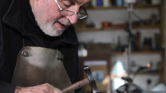 Master goldsmith working with silver in his workshop Stock Footage