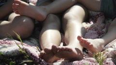 Legs of children outdoors Stock Footage