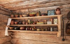 Vintage wooden shelf with old ceramic tableware Stock Photos