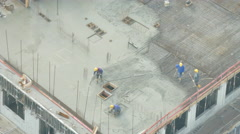 Constructors on building site as sun appears Stock Footage