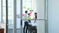 Young fashion designers working in studio - stock footage