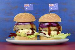 The Great Aussie BBQ Burger - with barbeque beef burgers and salad piled high Stock Photos