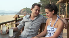 Couple at beach bar - stock footage