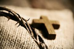 Wooden cross and the crown of thorns of Jesus Christ Stock Photos