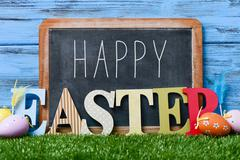 Decorated eggs and text happy easter Stock Photos