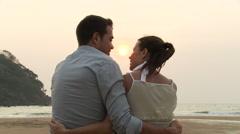 Couple on beach at sunset - stock footage