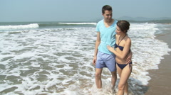 Couple walking by sea - stock footage