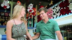 Stock Video Footage of Teenage couple at fun fair