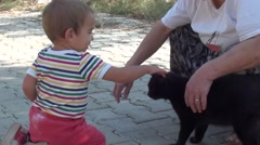 Small boy strokes a black cat Stock Footage