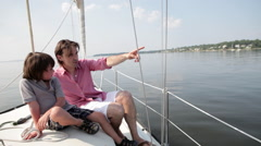 Father and son sailing on yacht Stock Footage