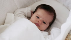 Sleepy baby girl in bassinet Stock Footage