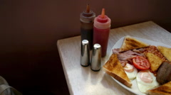 English breakfast on a cafe table Stock Footage