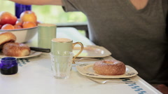 Man pouring juice, tilt up to show couple talking Stock Footage