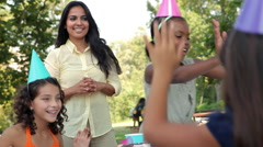 Girls giving high fives at birthday party Stock Footage