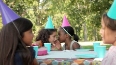 Girls whispering at birthday party Stock Footage