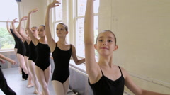 Ballet teacher correcting ballerinas posture Stock Footage