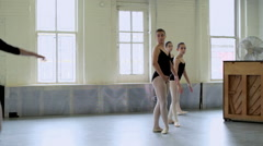Ballerinas pirouetting in studio Stock Footage