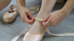 Girls putting on ballet shoes Stock Footage