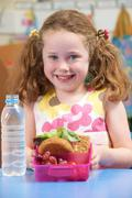 Elementary School Pupil With Healthy Lunch Box Stock Photos