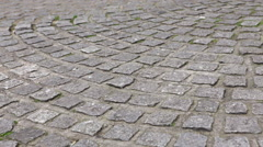 Person walking on cobbled street, low section Stock Footage