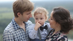 Young Family Playing in The Park Stock Footage