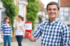 Teenage Boy Collecting For Charity In Street - stock photo