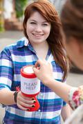 Teenage Girl Collecting For Charity - stock photo