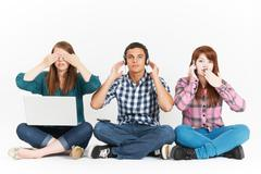 Teenagers In 3 Wise Monkeys Pose Holding Gadgets Stock Photos