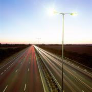 Head and tail-lights on motorway Stock Photos