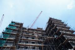 Construction of multi-storied building - stock photo