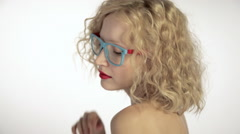 Young woman wearing glasses - stock footage