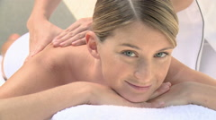 Young woman having a massage - stock footage
