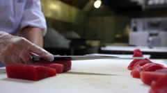 Sushi chef cuts fresh tuna, close up Stock Footage